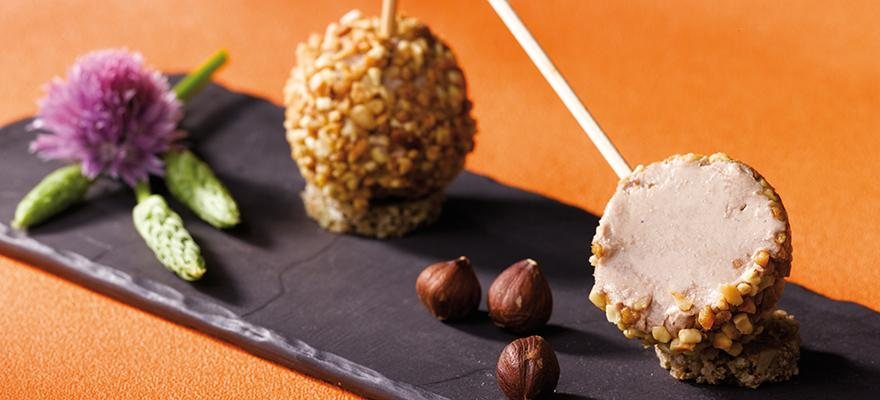 Lollipop of duck mousse with hazelnuts